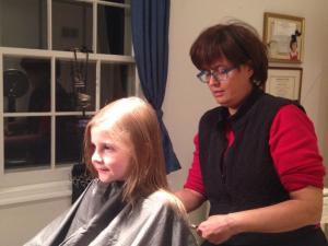 Margie Billian cutting hair